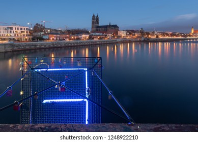 Magdeburg, Germany - December 4, 2019: View of the skyline of Magdeburg with the cathedral and the river Elbe at the blue hour, Germany.