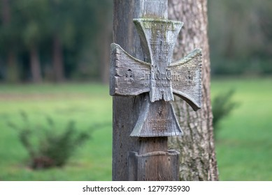 Magdeburg, Germany - January 7, 2019: View of a wooden cross for a soldier who died in World War I, Westfriedhof Magdeburg.