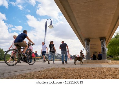 MAGDEBURG, GERMANY – JULY 08, 2018: Strollers on a summer day on the banks of the River Elbe in Magdeburg