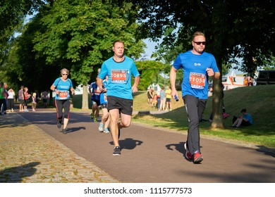MAGDEBURG, GERMANY – JUNE 14, 2018: Participants of the 10th company relay in the Elbauenpark in Magdeburg. Employees of many Magdeburg companies are fighting for victory