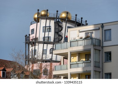 Magdeburg, Germany - March 12, 2019: View of the golden balls of the Hundertwasserhaus in Magdeburg, Germany.