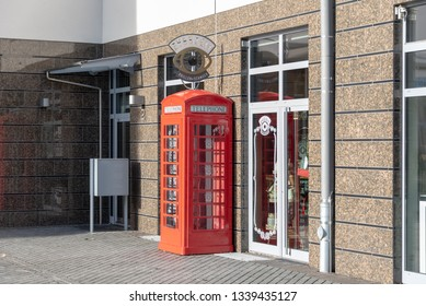 Magdeburg, Germany - March 12, 2019: View of a British telephone booth in downtown Magdeburg, Germany.