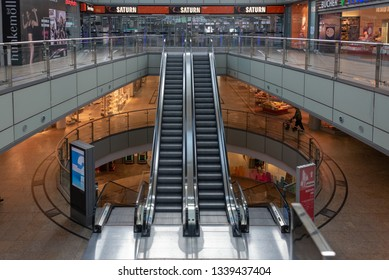 Magdeburg, Germany - March 12, 2019: A man walks past an escalator in a shopping center in Magdeburg, Germany.