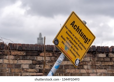 Magdeburg, Germany - March 18, 2019: View of a sign with the inscription  (Attention, life is dangerous. Use the bridge at your own risk.) The sign stands at the lift bridge in Magdeburg, Germany.