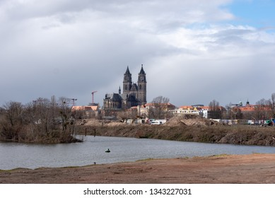 Magdeburg, Germany - March 19, 2019: View of the river Alte Elbe and the cathedral in Magdeburg, Germany.