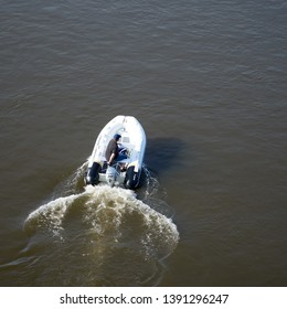 MAGDEBURG, GERMANY – MARCH 30, 2019: a motorboat driver photographed on the river Elbe near Magdeburg from a bridge