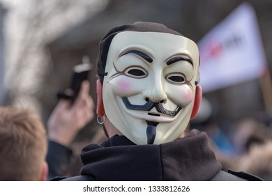 Magdeburg, Germany - March 9, 2019: : A demonstrator wears an anonymous mask. The man took part in a demonstration in Magdeburg by 1000 mostly young people against EU copyright reform.
