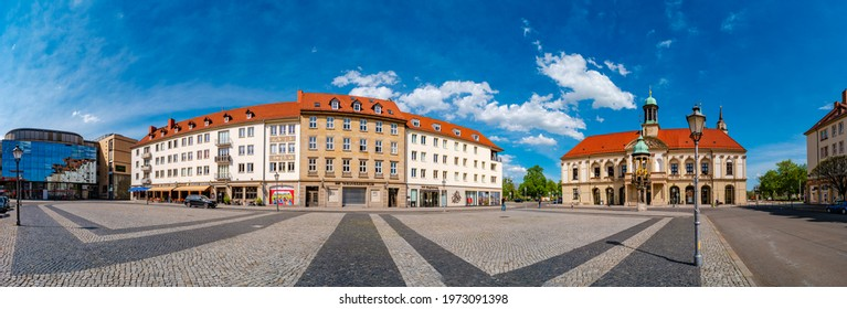 Magdeburg, Germany - May 10, 2021: Panoramic view at City Hall (Rathaus), Golden Equestrian statue of Magdeburger Reiter and Alter Markt Square in Magdeburg at blue sky and sunny day