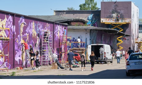 MAGDEBURG, GERMANY – MAY 20, 2018: Graffiti artist on the grounds of the Aerosol Arena in Magdeburg. The Aerosol Arena is a former company site that was provided to graffiti sprayers