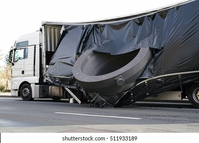MAGDEBURG, GERMANY ?? NOVEMBER 01, 2016: Accident of a heavy load transporter in the inner city of Magdeburg. The charge slipped and fell on the road