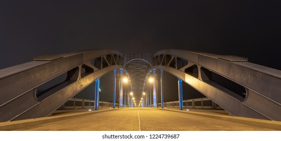Magdeburg, Germany - November 4, 2018: Nightly view of the Sternbrücke, a landmark of the city of Magdeburg, Germany.