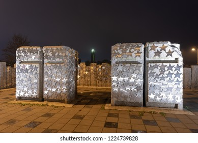 Magdeburg, Germany - November 4, 2018: View of granite columns with stars containing inscriptions from private individuals and sponsors. The work of art stands at the Sternbrücke in Magdeburg,