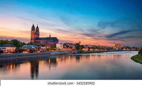 Magdeburg, Germany. Panoramic cityscape image of Magdeburg, Germany with reflection of the city in the Elbe river, during sunset.