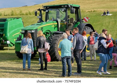 MAGDEBURG, GERMANY – SEPTEMBER 16, 2017: Visitors of the harvest festival in the Elbauenpark in Magdeburg during the presentation of new agricultural machines
