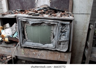 MAGELANG, CENTRAL JAVA, INDONESIA - CIRCA OCTOBER 2010: A television in a house in Central Java hit by a pyroclastic flow from the eruption of Mount Mirapi circa October 2010,  in Magelang, Central Java. Indonesia. The eruption has killed more than 350 p