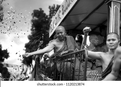 Magelang, Central Java / Indonesia - May 29 2018: A monk throws flower petals towards Buddhists during the Vesak D