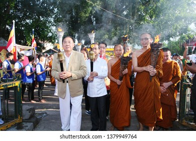 """Magelang, Central Java / Indonesia - May 16, 2018 : Taking """"Api Dhamma Tri Suci Waisak"""" (Eternal Fire) 2562 BE / 2018 in the eternal fire area of Mrapen to be taken to the temple of Mendut (Vesak Day)"""