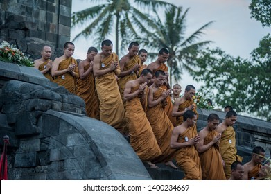 Magelang, Central Java, Indonesia - May 5, 2012 : Monks and Buddist People Pray in Mendut Temple (Vesak Day)