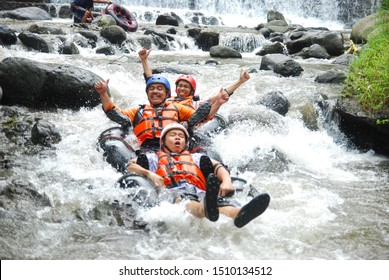 Magelang, Indonesia - April 22, 2018: a fun holiday with friends by playing rafting on Little Ubud River Tubing