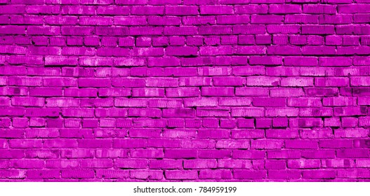Magenta brick wall for background or texture. Texture of old brick wall surface. Painted wall. Pink