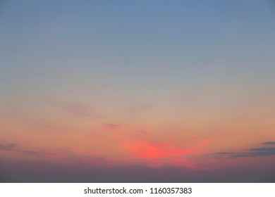 Magenta clouds in the sky with a magical light during the sunset
