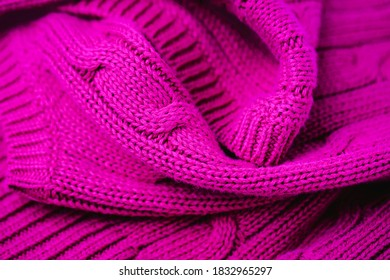 Magenta color texture background, knitted fabric background