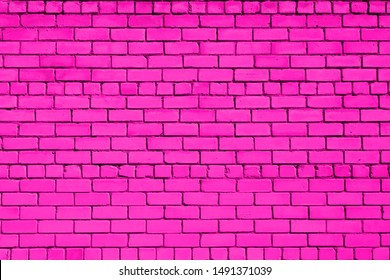Magenta colored brick background. Brick wall.