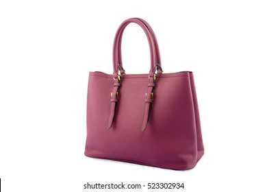 Magenta female leather bag isolated on white background.
