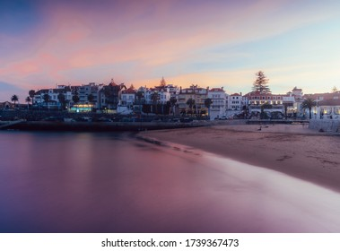 Magenta sunset overlooking the bay and historic centre of Cascais, Portugal - fine art dreamy style