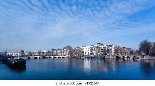 Magere Brug bridge on the Amstel River in Amsterdam on a cold winters day