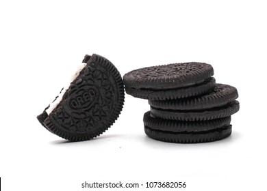 MAGETAN,  INDONESIA – April 18,  2018: Oreo Cookies isolated on white background. Consisting of two chocolate wafers with a sweet cream filling in between. Oreo made by Mondelez International.