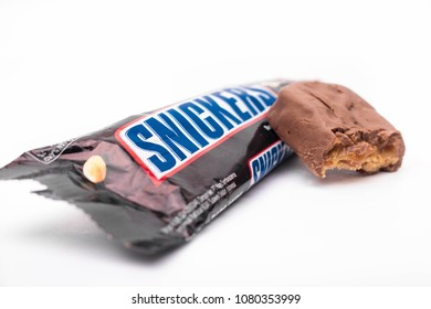 MAGETAN, INDONESIA APRIL 28, 2018. Snickers chocolate bar isolated on white background. Snickers bars are produced by Mars Incorporated.