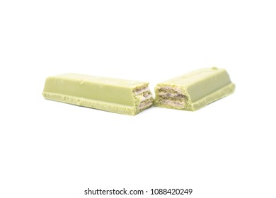 MAGETAN, INDONESIA – May 1, 2018: Kit Kat Chocolate Milk Wafer Green Tea flavored isolated on white background. Kit Kat bars are produced by Nestle. Brand Kit Kat was registered in 1911.
