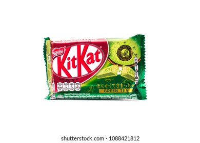 MAGETAN, INDONESIA – May 1, 2018:: Kit Kat Chocolate Milk Wafer Green Tea flavored isolated on white background. Kit Kat bars are produced by Nestle. Brand Kit Kat was registered in 1911.