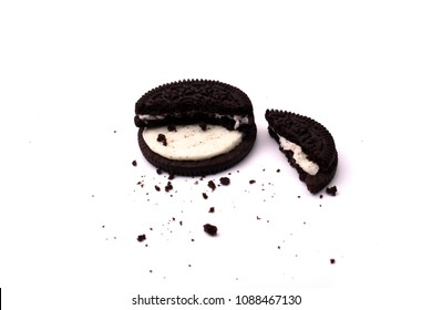 MAGETAN, INDONESIA – Mei 11, 2018: Oreo cookie consisting of two chocolate wafers with a sweet creme filling in between onthe white background. Oreo made by Mondelez International.