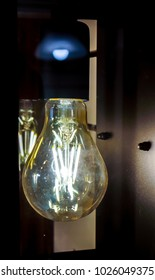 magic ball lamp with two long luminous springs with blurry effect as edison style against black background.