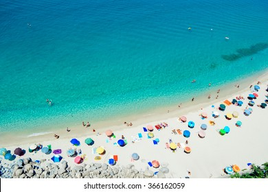 Magic beach in Tropea with colorful umbrellas