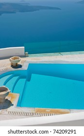 Magic blue swimming pool on island of Santorini, Fira in Greece. Caldera view on a background.