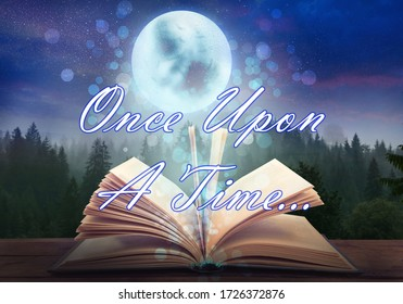 Magic book of fairy tales against landscape with forest and full moon at night - Shutterstock ID 1726372876