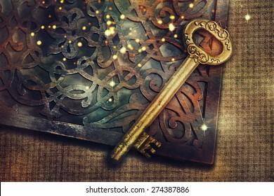 Magic book with gold vintage key