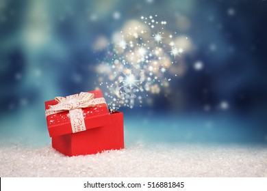Magic Christmas gift box, opened gift box with stars and light, surprise