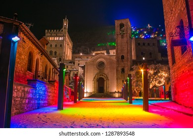 Magic colored square in the center of Gubbio at christmas time with snow