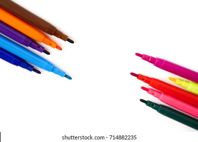 Magic colorful pens on a white background. Free space for text