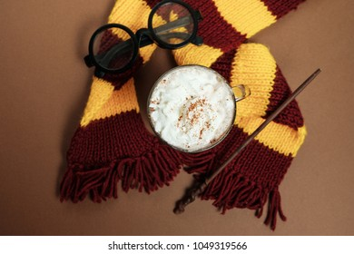 Magic composition with a cup of cocoa, a magic wand, a scarf on a vintage background. Top view, flat lay