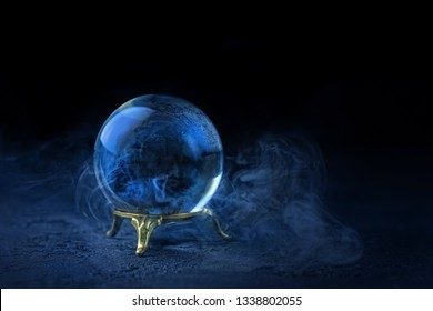 magic crystal ball for predictions on dark blue background. mystical Fortune teller ball, prediction, mind power concept. witchcraft ritual for summoning spirits and divination. copy space