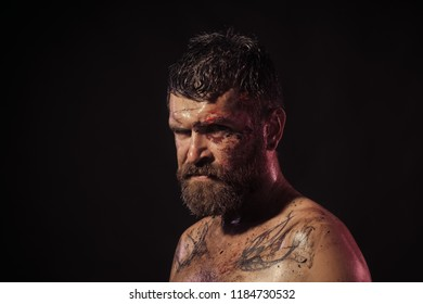 Magic, enchantment, witchcraft. Hipster with beard, mustache on serious dirty face. Bearded man with tattoo on chest skin. Wizard, sorcerer, warlock. Halloween, holidays celebration copy space