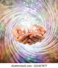 Magic - Female cupped hands emerging from twirling energy field with multicolored background and sparkles