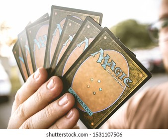 Magic: the Gathering, MTG. Man holding some playing cards. Bond of insight. Brasilia, Federal District - Brazil. October, 14,  2019.