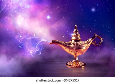 Magic genie lamp with smoke on a dark background