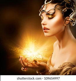Magic Girl Portrait. Golden Makeup.